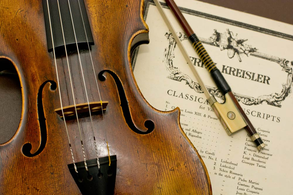 violin string and bow with sheet music photograph